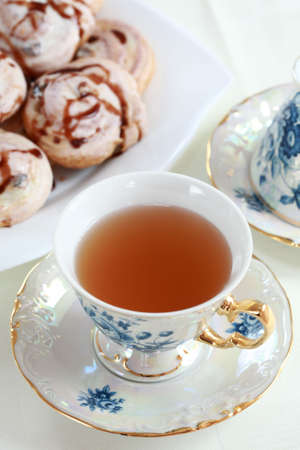 Cup of fruit tea with delicious cookies Stock Photo - 5079966