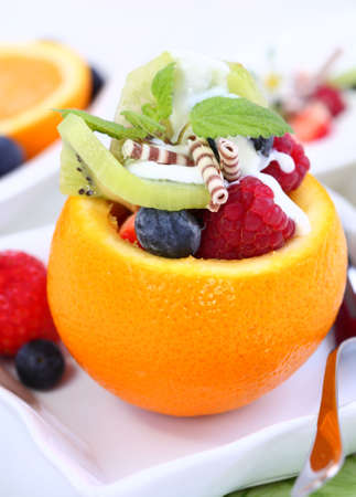 calorie: Low calorie dessert - orange filled with fruits Stock Photo