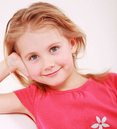 smart girl: Beautiful small girl is smiling  sincerely  Stock Photo