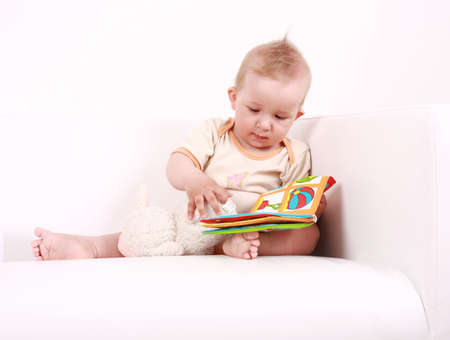 Portrait of cute baby reading a picture book