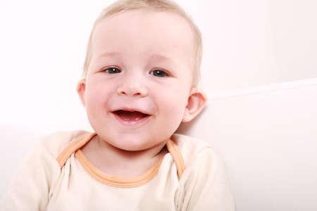 Portrait of cute newborn laughing  Stock Photo - 5253763