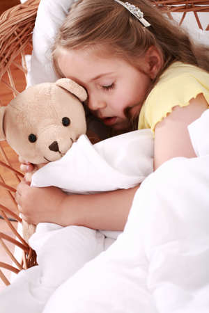 cuddly baby: Portrait of cute little girl sleeping with teddy