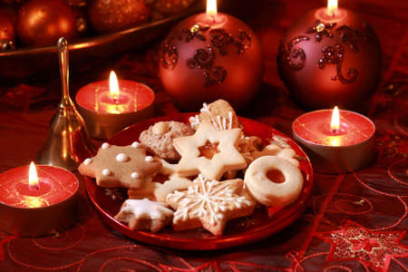 Detail of delicious Christmas cookies with candles in red tone Stock Photo - 5397214