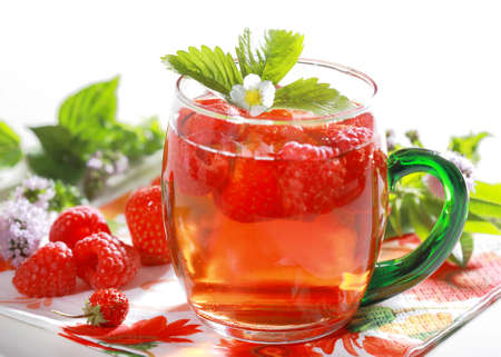 Refreshing summer ice tea with fruits and herbs photo