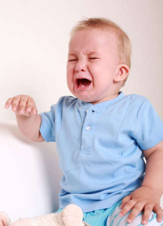 sobbing: Portrait of crying baby Stock Photo