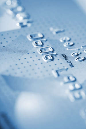 expires: Detail of credit card as background in blue tone