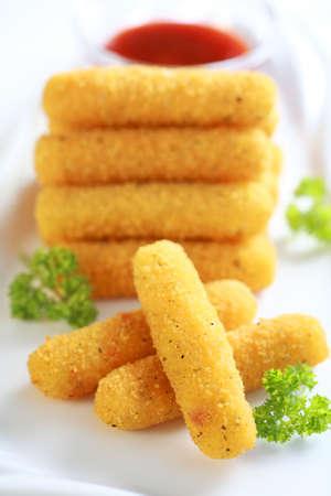 fried snack: Delicious mozzarella fried sticks with tomato sauce