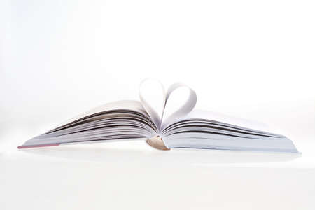 pressman: Detail of open book with heart shape, close-up