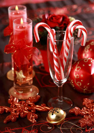 Sweet candy canes for Christmas in glass in red tone photo
