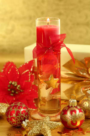 Christmas still life with candle in golden and red tone Stock Photo - 6039108