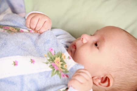 Portrait of adorable baby lying in bed Stock Photo - 6047401