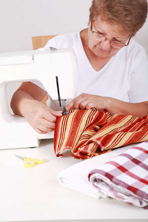 Photo of elderly woman sewing  photo