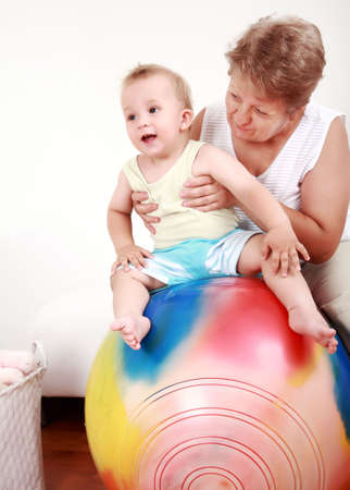 nana: Small boy have a fun with the gymnastic ball Stock Photo