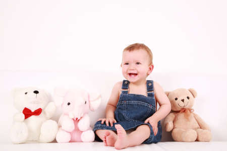 plush toy: Portrait of cute laughing baby with plush toys