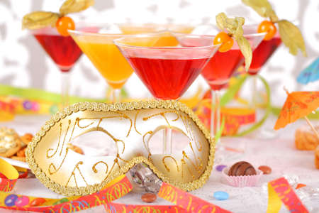 Party drinks with carnival mask photo