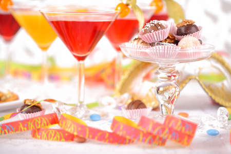 Party drinks with delicious sweets photo