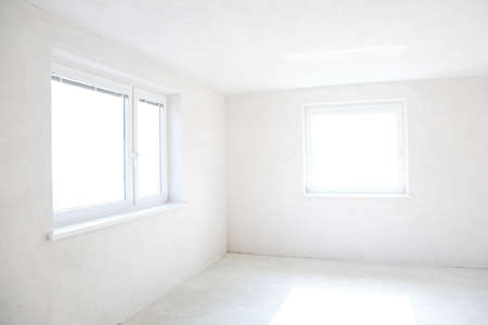 unfurnished: Moving in or out - empty room with two windows