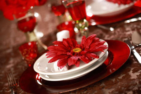 Luxury place setting in red and white  for Christmas or other event photo