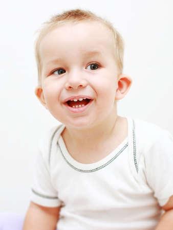 Portrait of cute newborn laughing  photo