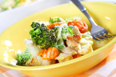 Baked mixed vegetable with chicken breast and oregano photo