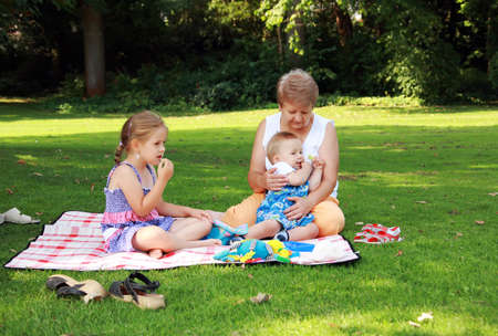Kids have a small picnic with grandma Stock Photo - 6743411