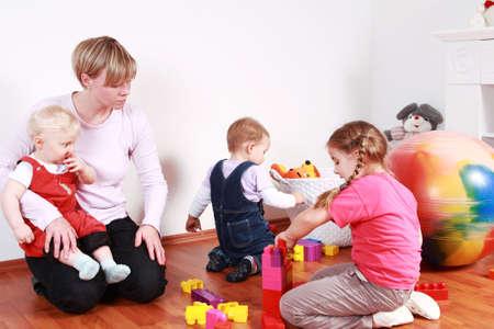 preschool: Kids in kindergarten with their teacher Stock Photo
