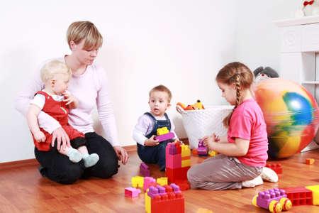 Kids in kindergarten with their teacher Stock fotó