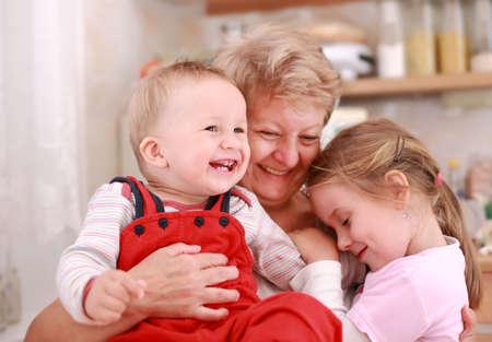 grandmother children: Lindo ni�o y ni�a feliz con la abuela