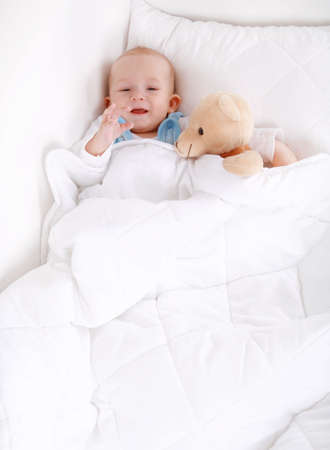 cuddly baby: Portrait of cute cute little baby with teddy