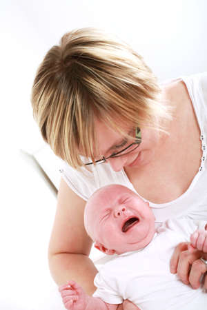 heartbreaking: Mother trying to rest her baby Stock Photo