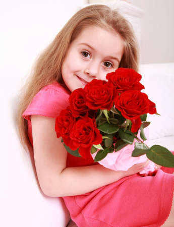 Beautiful small girl with bouquet - for Mothers day photo