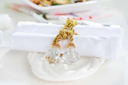 napkin ring: Luxury napkins with napkin ring on the white tablet Stock Photo