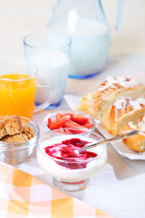 Healthy breakfast or snack with yogurt, pound cake and fresh fruits photo