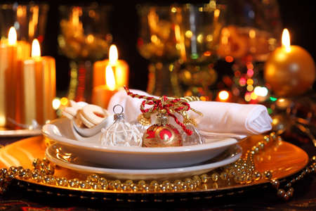 Luxury place setting in golden and white  for Christmas  photo