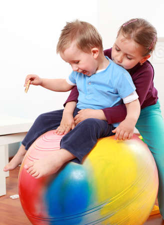 Kids have a fun with the gymnastic ball Stock Photo - 7140290