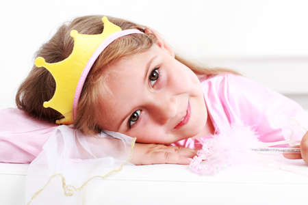 Beautiful small girl dressed as princess photo