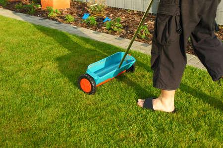 fertilizing: Gardening - fertilizer spreader for small gardens Stock Photo