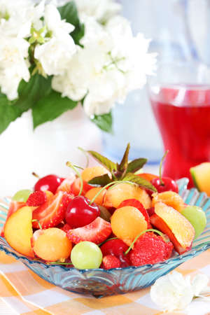 Delicious fresh fruits served in bowl as dessert photo