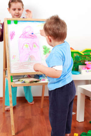 Adorable kids playing with chalkboard Stock Photo - 7186044