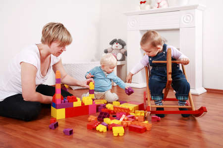 Kids in kindergarten with their teacher Stock Photo