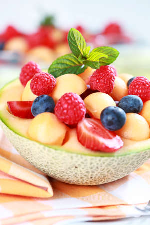 Delicious fresh fruits served in melon bowl as dessert