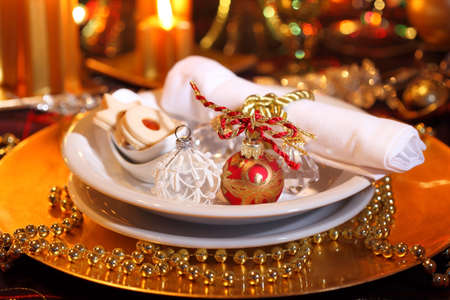 Luxury place setting in golden and white  for Christmas Stock Photo - 7253422
