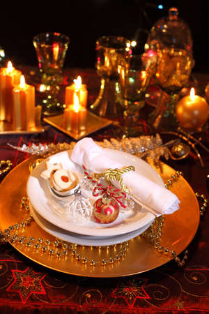 Luxury place setting in golden and white  for Christmas Stock Photo - 7253423
