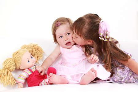 cuddly baby: Kids giving a kiss to each other Stock Photo