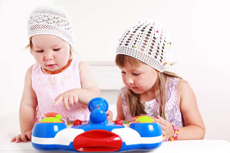Adorable kids playing playing together photo