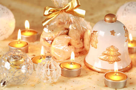 Christmas still life with candles and cookies in golden tone photo