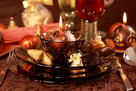 Luxury place setting in golden and brown  for Christmas Stock Photo - 7609845
