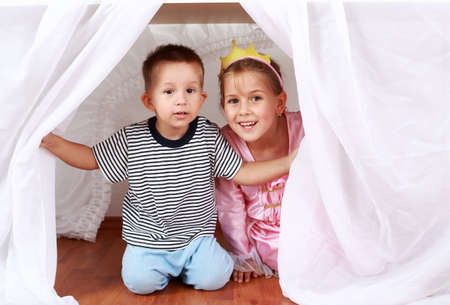 Adorable kids playing hide-and-seek at home photo