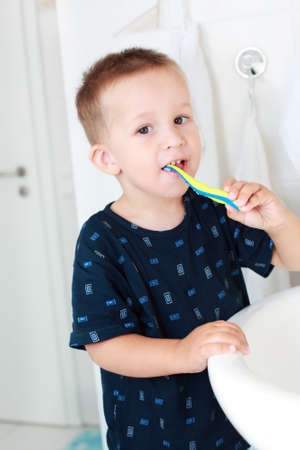 Dental care  - small boy washing his teeth Stock Photo - 7728180