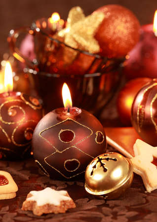 Christmas still life with candles and cookies in brown and red tone Stock Photo - 7843592